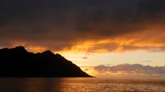 Panning shot of sunset clouds, sea and mountains. Senja island, Norway Stock Footage