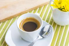 A cup of coffee or hot coffee on wooden table , soft-tone and soft focus Stock Photos