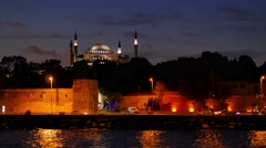 Stock Video Footage of istanbul skyline cityscape hagia sophia mosque at night seen from bosphorus s