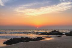 Sunset at sea beach Stock Photos