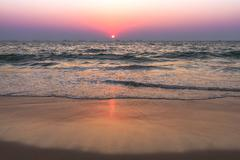 Sunset at sea beach - stock photo
