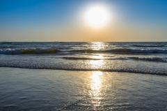 Sunrise at sea beach - stock photo