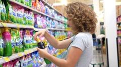 Woman Choosing Washing Powder in Supermarket Stock Footage