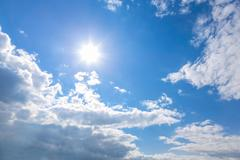 Sun and clouds on sky - stock photo