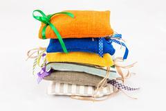Decorative textile sachet pouches - stock photo