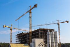 Building cranes on construction - stock photo
