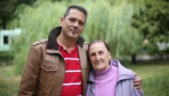 Stock Video Footage of Family values: Portrait of seniors mother and son in autumn park