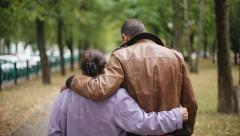 Family values: Seniors mother and son walking in autumn park Stock Footage