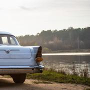 Stock Photo of Old retro or vintage car back side
