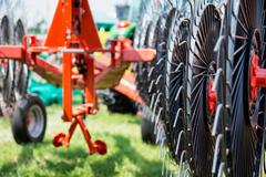 Hay rake farm machinery equipment - stock photo