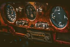 Dashboard in old retro car. Vintage effect processing Stock Photos
