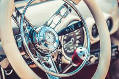 Stock Photo of Retro interior of vintage car. Vintage effect processing