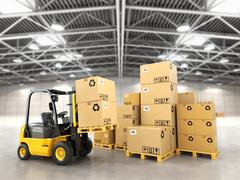 Forklift truck in warehouse or storage loading cardboard boxes. Piirros
