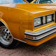 Stock Photo of Old retro or vintage car front side