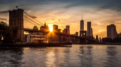 New York timelapse with Brooklyn Bridge going through sunset, twilight and night - stock footage