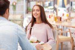 Attractive young loving couple is dating in cafe Stock Photos
