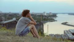Depressed upset man distressed in park - stock footage