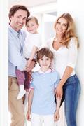 happy family inside house - stock photo