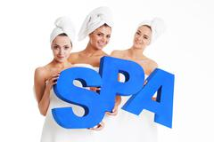 women holding spa letters - stock photo
