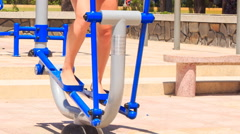 Closeup girl's legs train on stepper on sport ground Stock Footage