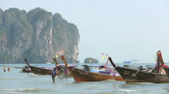Man anchoring traditional longtail boat in Ao Nang, Krabi, Thailand Stock Footage