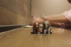 Plastic animal toy with figure people Stock Photos