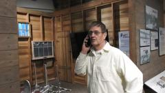 Man on a cell phone in a museum Stock Footage