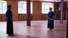 4K Japanese kendo fighters training together with bamboo swords Stock Footage