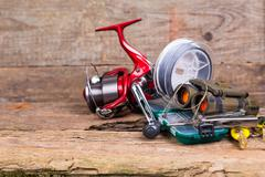 fishing and tourism gear on timber board - stock photo