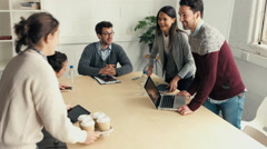 Handshake at business meeting showing teamwork - stock footage