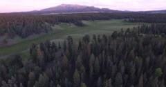 4K Aerial - Sunset Pikes Peak forest flyover Stock Footage
