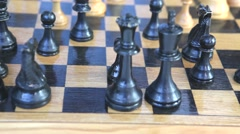 Wooden chess pieces and the board spinning around - stock footage