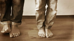 A funny footage of mom's and her son's legs in jeans fooling around Stock Footage