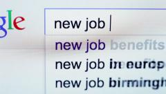 A request for a new job being typed into the Google search line by employee Stock Footage