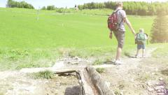 Son and his father on the mountainous walk with their family pet Stock Footage