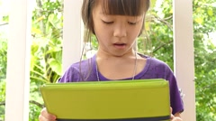 asian looking cartoon in touchscreen devices - stock footage