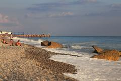 Black sea beach seashore tide waves sky Stock Photos