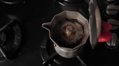 Making coffee on a gas cooker Stock Footage