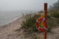 Life Ring Lake Michigan Fog - stock photo