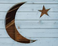 Crescent Moon and Star Shapes in Wood Stock Photos