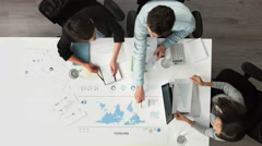 Business meeting arial view showing teamwork - stock footage