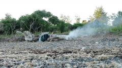 Smoking Campfire on beach Stock Footage