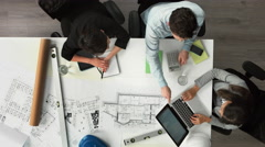 Architect plans arial view business meeting showing teamwork Stock Footage