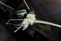Flower bouquet on a wedding car - stock photo