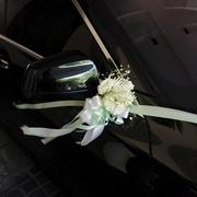 Flower bouquet on a wedding car - stock photo