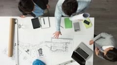 Architect plans arial view business meeting showing teamwork - stock footage