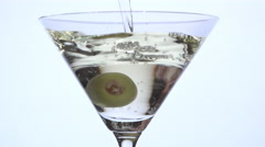 Pouring martini dry over olive Stock Footage