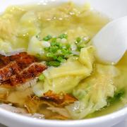 Shrimps wontons served with sliced roast duck - stock photo