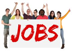 Jobs sign group of young multi ethnic people holding banner - stock photo