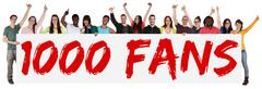 1000 fans likes social networking media sign group of young people holding ba - stock photo